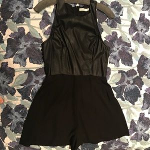 Black romper with faux leather.